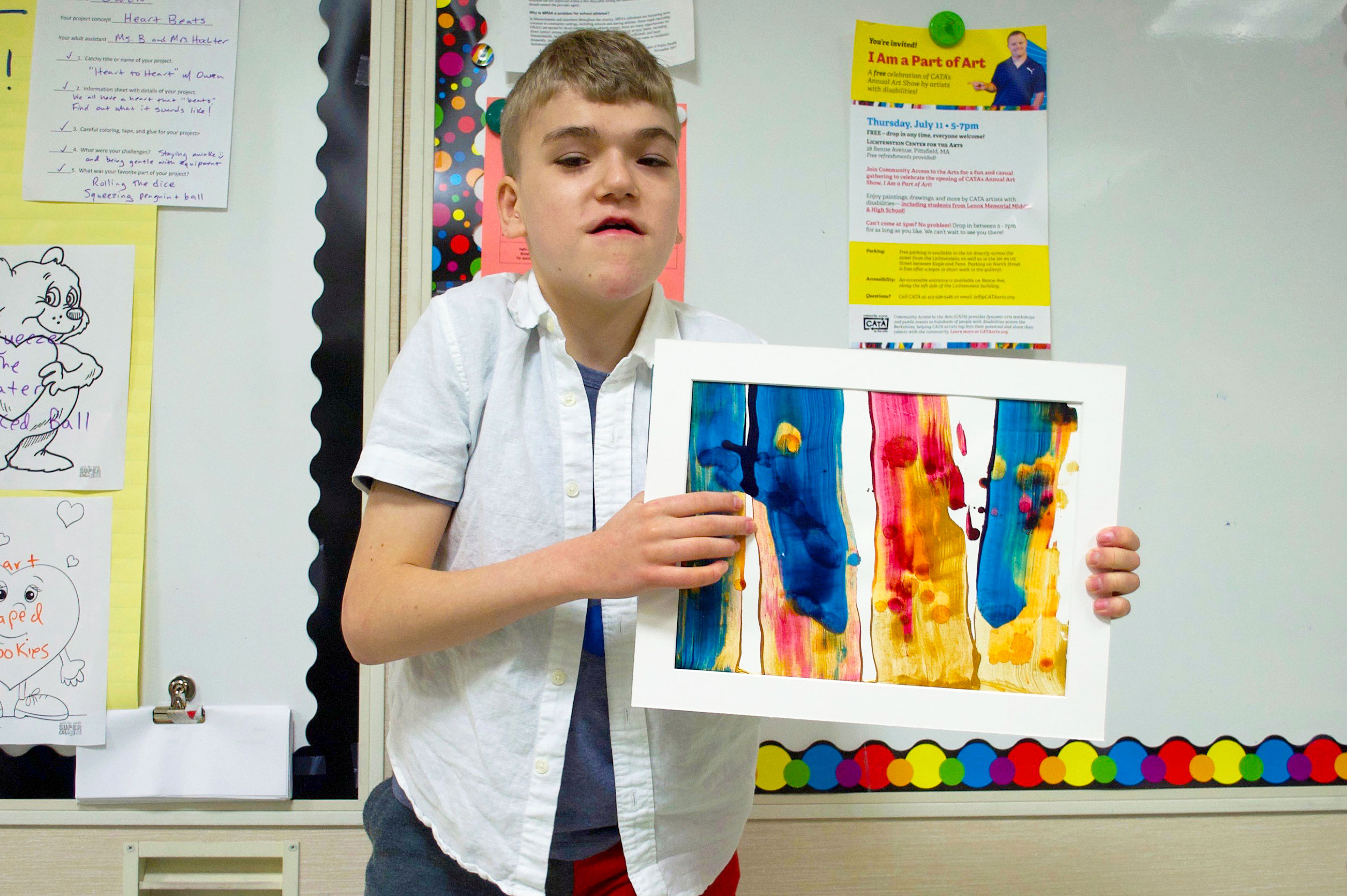 Middle School CATA artist Owen proudly holds his painting that we created in a CATA workshop
