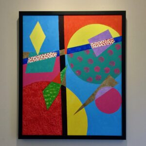 Painting with asymmetrical geometric design with pastel colors and small polka dots in some shapes. In a thin, black frame.