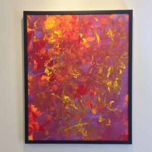 Painting with layers of red-orange and purple with flecks of yellow and orange polka dots. In a thin, black frame.