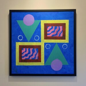 Painting with mirrored design of two bright pastel triangles, two squares, and multiple circles on a blue background. In a thin, black frame.