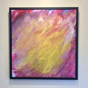 Painting with a blend of magenta, white, and yellow all going the same direction, from the bottom left to the top right of the canvas, in a thin, black frame.