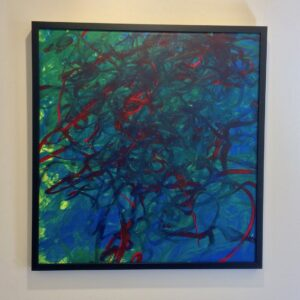 Painting with deep red thin brushstrokes blended into a green and blue background. In a thin, black frame.