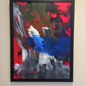 Painting with large grey, white, blue, green, and black strokes on a red background, in a thin, black frame.