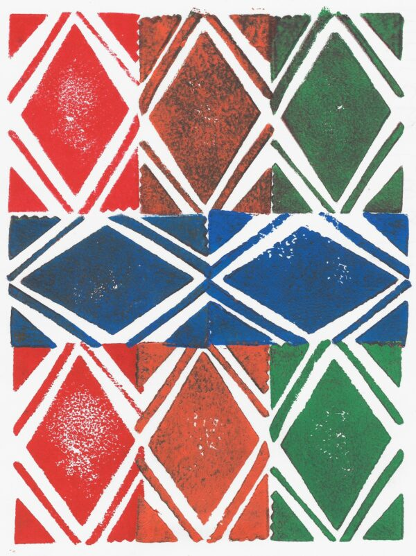 A hand-printed pattern made up of blue, green, orange, and red diamonds.
