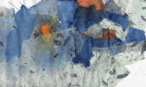 A blue and mint green paper collage with flecks of orange.