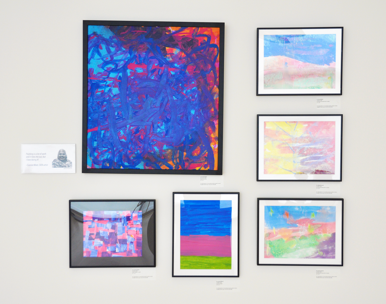 Six paintings on a wall