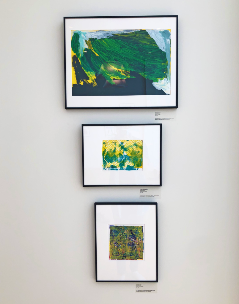 Three paintings on a wall