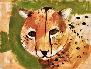 Image: Portrait of a cheetah on green background