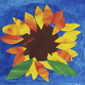Paper collage and painted sunflower with brown circle center, yellow and orange petals, and two green leaves at the bottom. Medium-blue painted background.