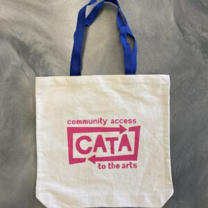 Image description: Tote bag with bright blue handles and pink CATA logo